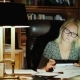 A Business Woman in Glasses Works in Her Office with Documents. Late Evening - Work Late - VideoHive Item for Sale
