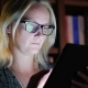 A Woman Works with a Tablet in the Library Late at Night. Work Until Late - VideoHive Item for Sale