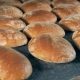 Round Bread Loaves Leave the Oven on a Conveyor - VideoHive Item for Sale