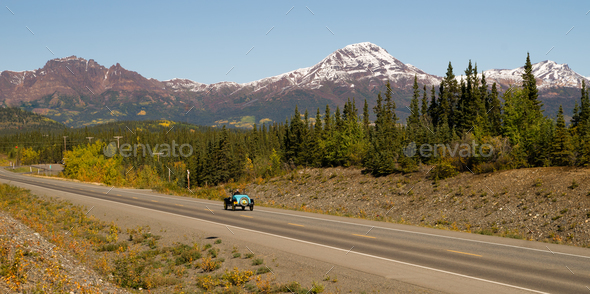 Vintage Car Travels North Highway Alaska Mountain Range Transportation - Stock Photo - Images