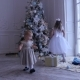 Children Near the Christmas Tree. Two Little Girls at Home, Christmas, New Year - VideoHive Item for Sale