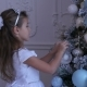 Child Decorating the Christmas Tree, Little Girl Decorating the Christmas Tree - VideoHive Item for Sale