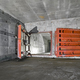 Concrete room underground with a ladder to the surface from which the light comes - PhotoDune Item for Sale