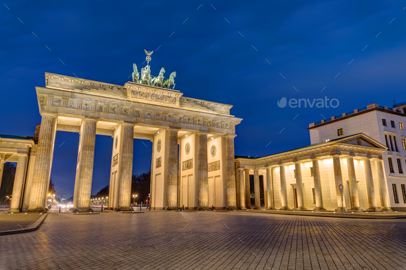 The Brandenburg Gate in Berlin at night - Stock Photo - Images