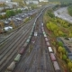 Junction Railway Station with Lots of Lines and a Moving Freight Train. Aerial View. Location - VideoHive Item for Sale
