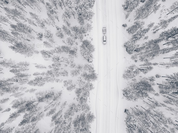 Aerial drone view of winter forest and road covered with snow. - Stock Photo - Images
