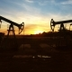 Moving Between Two Working Oil Pumps To Sunset - VideoHive Item for Sale