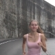 Female Jogging on Road Near Rock Cliff - VideoHive Item for Sale