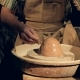 A Potter Wets a Large Lump of Clay on a Wheel - VideoHive Item for Sale