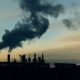 Smoke Slowly Comes Out of Several Pipes in the Factory Against the Sky at Sunset - VideoHive Item for Sale