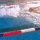 Aerial Shot of a Swimmer in a Swimming Pool - VideoHive Item for Sale