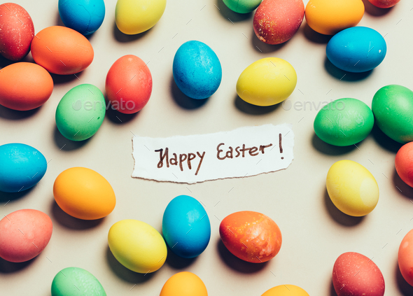 """Bunch of colorful eggs and """"Happy Easter"""" card - Stock Photo - Images"""
