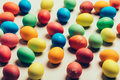Couple of colorful eggs laying on a creamy background. - PhotoDune Item for Sale