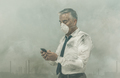 Businessman having a phone call and toxic smog - PhotoDune Item for Sale