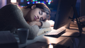 Woman sleeping on the desk at night - PhotoDune Item for Sale