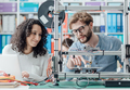 Engineering students using a 3D printer - PhotoDune Item for Sale