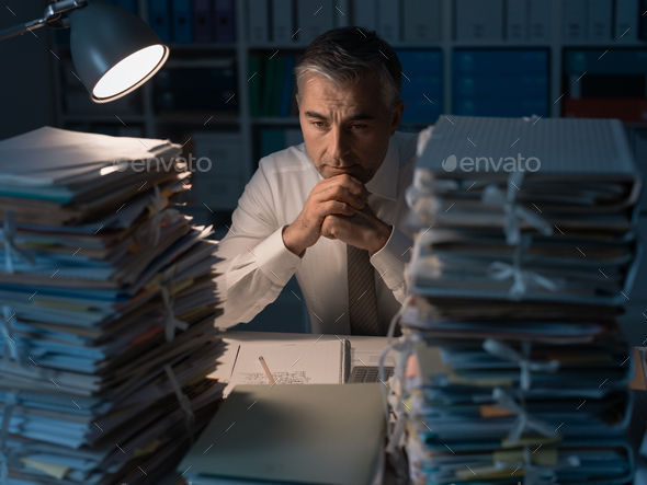 Business executive overloaded with work - Stock Photo - Images