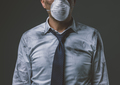 Businessman with mask and air pollution - PhotoDune Item for Sale