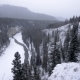 Icy Winter River Winds Through Canyon Valley in Snowstorm - VideoHive Item for Sale