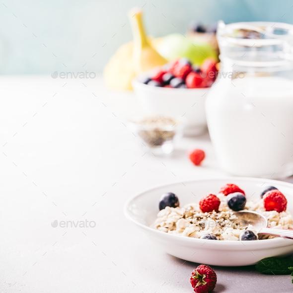 Oatmeal porridge with fresh berries - Stock Photo - Images