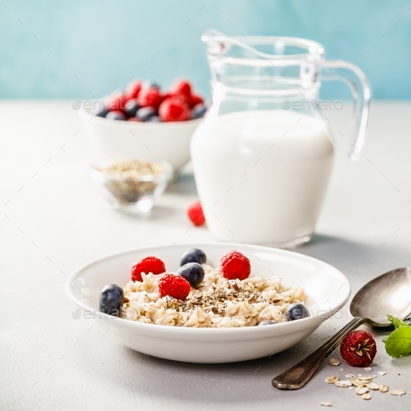 Oatmeal porridge with fresh berries - Stock Photo - Images