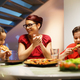 Home Dinner With Happy Family Eating Homemade Pizza - PhotoDune Item for Sale