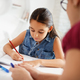 Hispanic Mother Helping Girl Doing School Homework At Home - PhotoDune Item for Sale