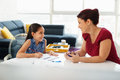 Education With Mom Helping Daughter Doing School Homework At Home - PhotoDune Item for Sale