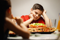 Mother Giving Salad Instead Of Pizza To Overweight Son - PhotoDune Item for Sale