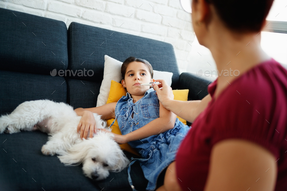 Mother Checking Temperature To Ill Daughter With Thermometer - Stock Photo - Images