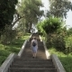 Young Girl Walking on Stairs in Tropical Botanical Garden. Batumi, Georgia - VideoHive Item for Sale