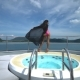 An Asian Girl in a Pink Swimsuit Posing Near Jacuzzi on a Luxury Yacht. - VideoHive Item for Sale