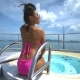 An Asian Girl in a Pink Swimsuit Sitting in a Jacuzzi on a Luxury Yacht. - VideoHive Item for Sale