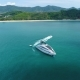 Aerial View of Luxury Yacht in the Sea Near the Beach. - VideoHive Item for Sale