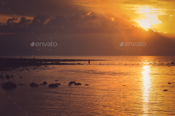 Sunset over the ocean in Flores - Stock Photo - Images