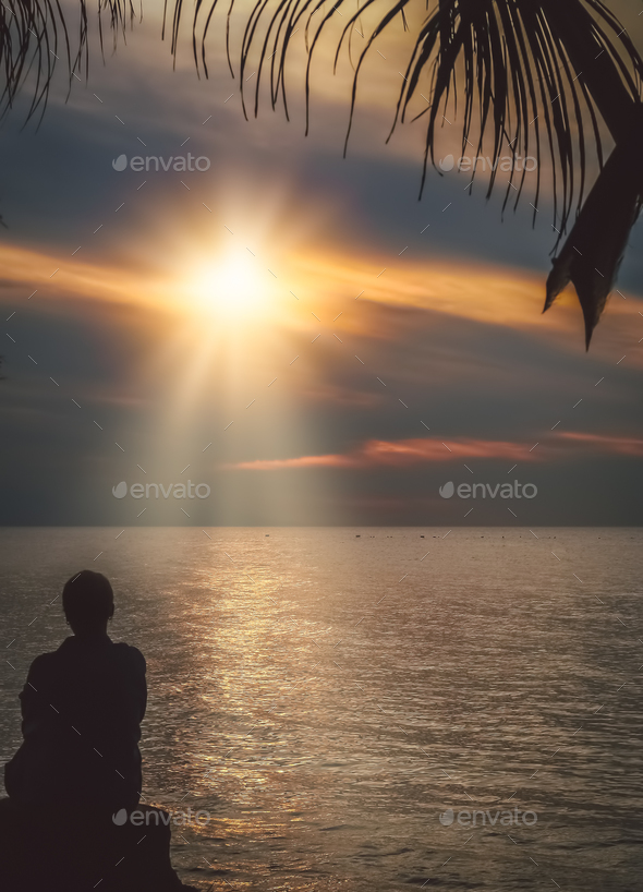 Admiring sunset on the Bali beach - Stock Photo - Images