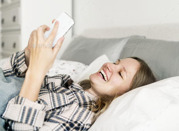Caucasian woman chatting on mobile phone - Stock Photo - Images