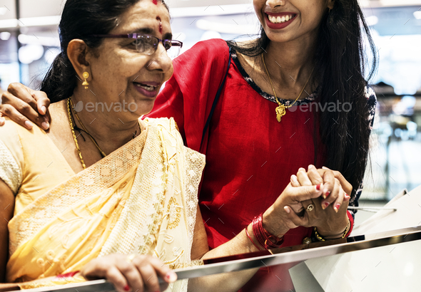 Indian family enjoying a shopping mall - Stock Photo - Images