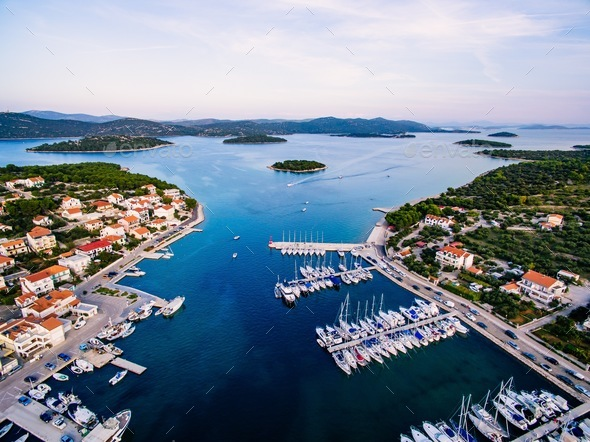 Aerial drone view of small marina with boats and yachts docked in Croatia - Stock Photo - Images