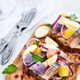 Open sandwich (smorrebrod) with herring, onion, potato and eggs - PhotoDune Item for Sale