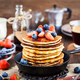 Stack of freshly prepared banana  pancakes with fresh berries - PhotoDune Item for Sale