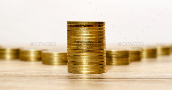 Money savings - golden coins - Stock Photo - Images