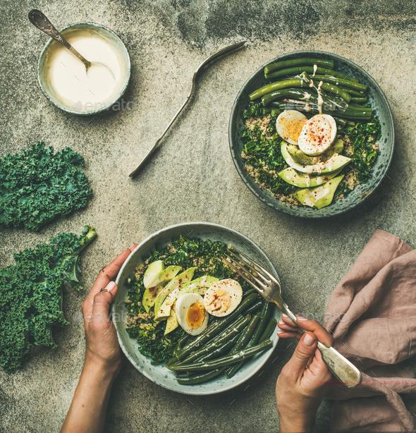 Quinoa, kale, beans, avocado, egg with creamy tahini dressing bowls - Stock Photo - Images