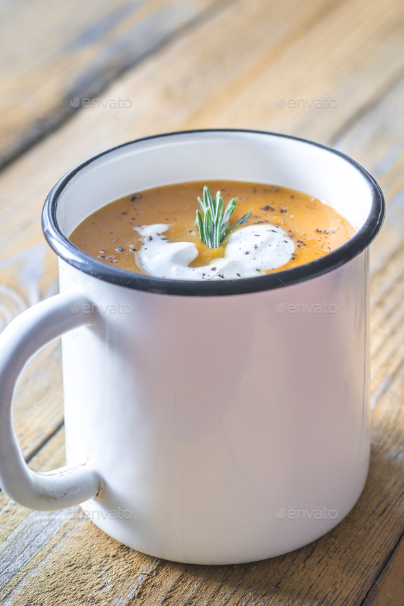 Mug of pumpkin cream soup - Stock Photo - Images