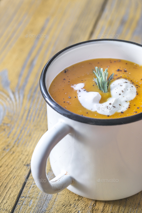 Mug of pumpkin cream soup - Stock Photo - Images