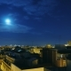 Moonrise Over the City and the Roofs of Houses.  From Evening To Dawn. The Sun Rises Over the City - VideoHive Item for Sale