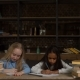Tired School Girls Studying with a Pile of Books - VideoHive Item for Sale