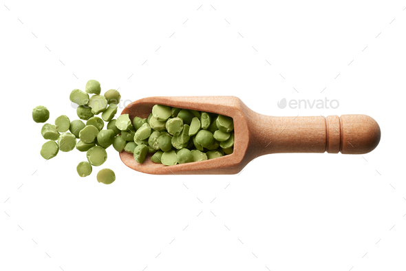 Dried green peas in a wooden scoop - Stock Photo - Images