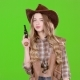 Cowgirl Holds a Revolver in Her Hands and Aiming at the Villain. Green Screen - VideoHive Item for Sale