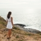 Woman Enjoying the Sunset on the Edge of a Cliff Near the Ocean - VideoHive Item for Sale